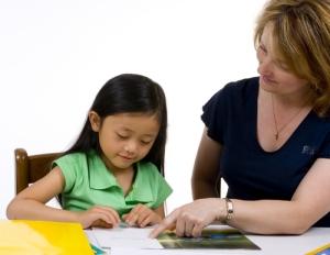 education-teacher-teaching-a-lil-girl