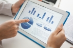 business-financial-reporting-tablet-tech-woman-chart-accounting